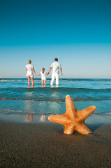 Summer vacation - family in beach resort (copy space)