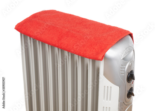 Electric heater covered by red towel
