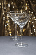 Martini glasses in front of glitter background