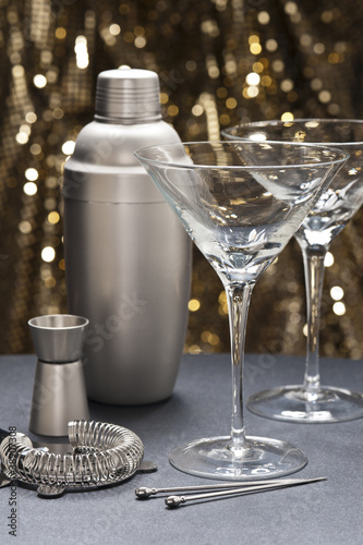 Two Martini glasses with bartender tools