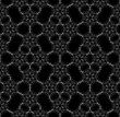 Seamless white lace pattern on black