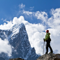 Woman hiking in Himalaya Mountains, trekking adventure
