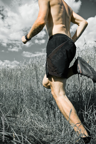 Man running cross country on trail, sport and fitness