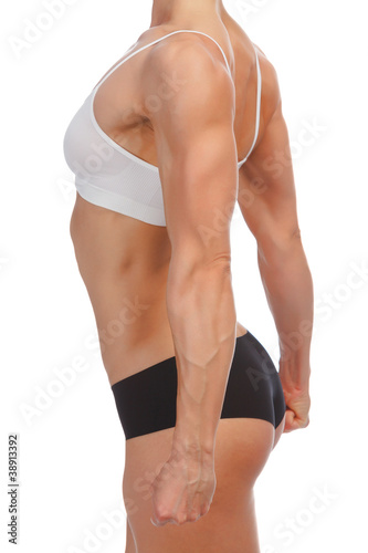 Female fitness bodybuilder posing against white background