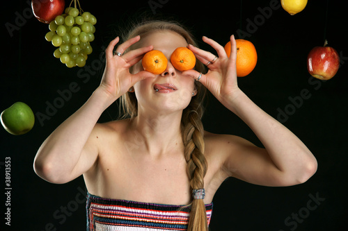The beautiful girl with fruit