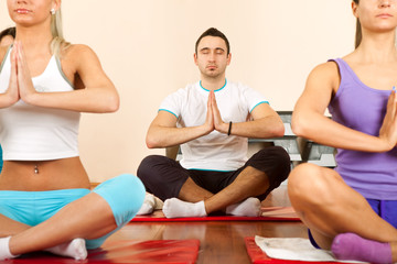 Group of young people doing yoga
