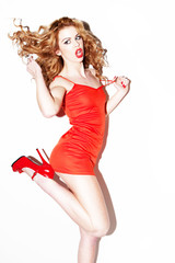 Vivacious Redhead Kicking Her Heels In The Air