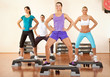 Healthy people doing exercises at gym