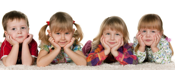 Four children lying on the carpet