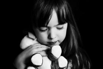Sad little girl alone,  bw