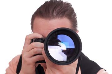 Fotograf mit Kamera und Teleobjektiv
