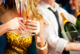 Couple with Champagner in club or party