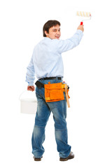 Construction worker with bucket and brush painting