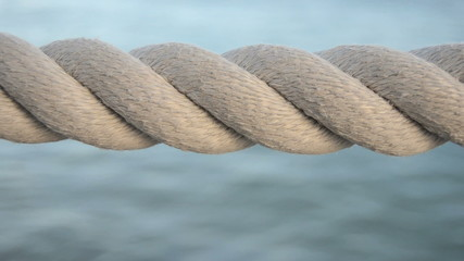 Harbor Rope Against A Blue Ocean Background