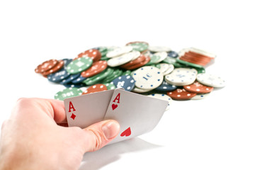 Male hand showing two aces