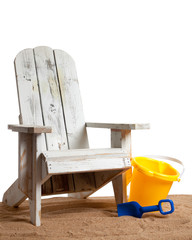 Adirondack chair with shovel/pail with sand on white