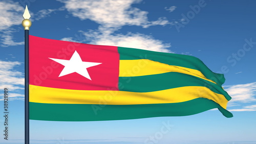 Flag Of Togo on the background of the sky and flying clouds.