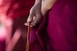 Leinwanddruck Bild - Prayer beads in monk's hand