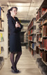 A Sexy librarian standing in the stacks