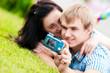 Happy teenage couple taking picture
