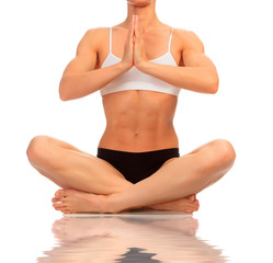 Muscular woman doing yoga exercise, isolated on white