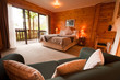 Interior of mountain wooden lodge bedroom - 38934318