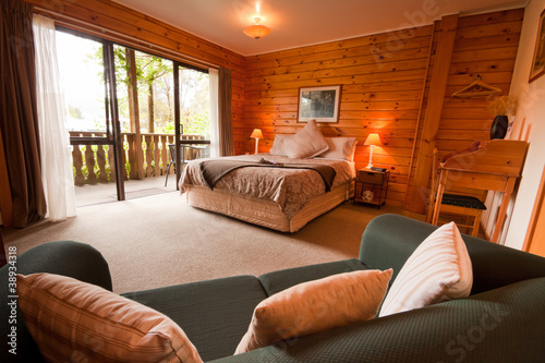 Leinwandbild Motiv Interior of mountain wooden lodge bedroom