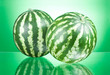 Two Watermelons isolated on a green background