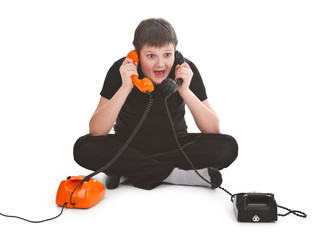 boy having two phone calls