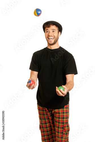 Young man juggling isolated on white background