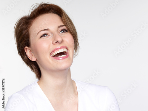 Close up of a laughing young woman