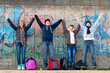 Happy teenage boys and girls having fun after the school