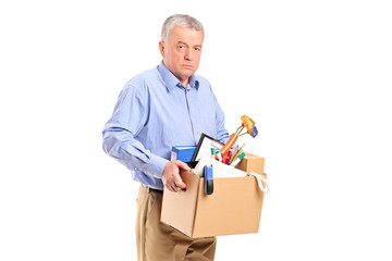 Fired man carrying a box of personal items