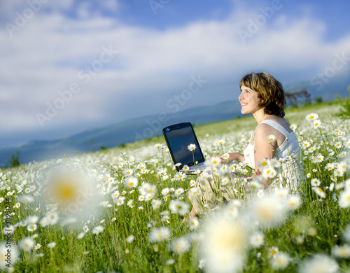 woman in camomile field