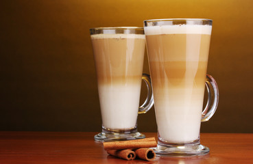 Fragrant сoffee latte in glass cups and cinnamon