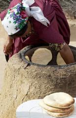 Impoverished women baking bread in Africa
