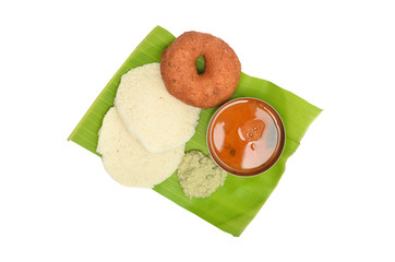 Idli vada with sambar and chutney served on banana leaf