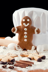 Gingerbread man, chef's hat, ingredients and kitchen utensils