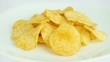 Potato chips on a white plate - rotation