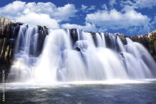 Beautiful watterfall with clear blue sky in background - 38961340
