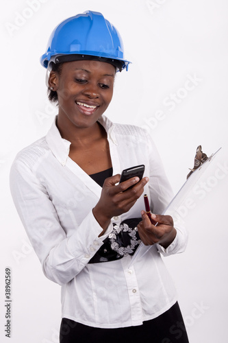 South African woman checking messages on her phone.