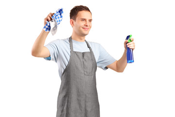 Young cleaner holding a cleaning supplies