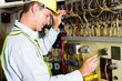 male caucasian electrician testing industrial machine