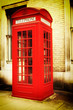 Retro image of a typical red London phone booth