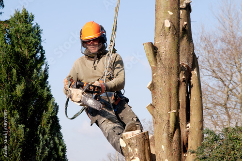 Man starting chainsaw