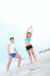 Couple workout on beach
