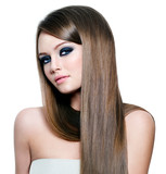 Portrait of beautiful woman with long straight hair