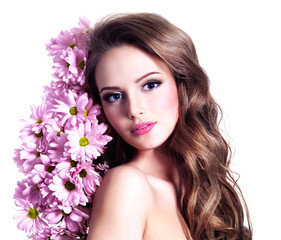 Beautiful sensual girl with pink flowers