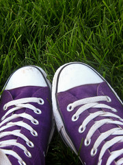 Purple sneakers in grass
