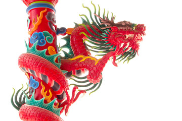 red dragon statue on pole